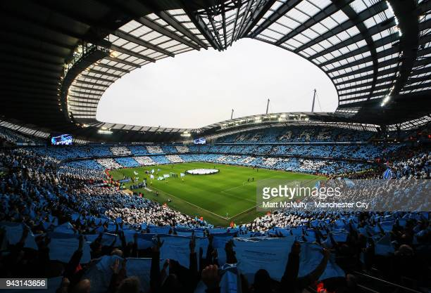 A general view of the Etihad Stadium as fans create a mosaic before the Premier League match between Manchester City and Manchester United at Etihad...