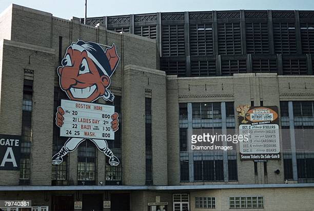 A general view of the exterior of Municipal Stadium showing the Chief Wahoo mascot upcoming games schedule and the Clleveland Browns football...