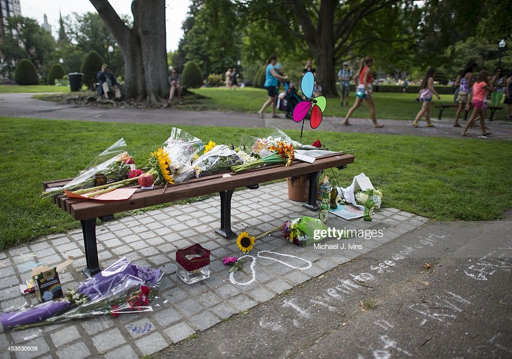 General view of the fan memorial in honor of Robin Williams on the bench made famous by his movie 'Good Will Hunting' in Boston Public Garden on August 12, 2014 in Boston, Massachusetts. Williams died after hanging himself on August 11, 2014 at his home in Tiburon, California.