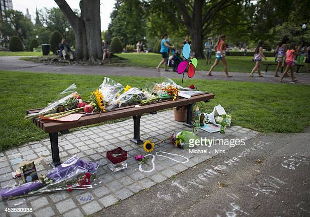 """General view of the fan memorial in honor of Robin Williams on the bench made famous by his movie """"Good Will Hunting"""" in Boston Public Garden on..."""