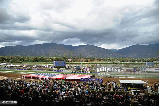 A general view of the field and flag during the singing of the national anthem before the 2014 Xpressbet Breeders' Cup Sprint at Santa Anita Park on...