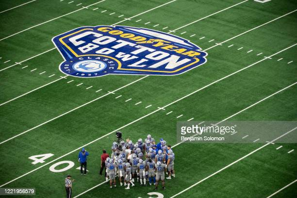 A general view of the field and the Memphis Tigers huddle during the Goodyear Cotton Bowl Classic at ATT Stadium on December 28 2019 in Arlington...