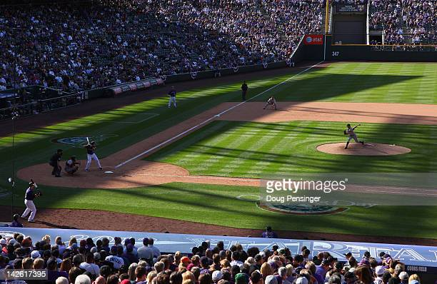General view of the field as starting pitcher Barry Zito of the San Francisco Giants delivers against the Colorado Rockies on Opening Day at Coors...