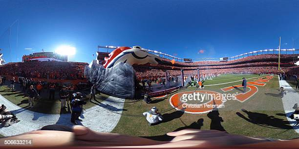 A general view of the field as the Denver Broncos run out of the tunnel in the AFC Championship game against the New England Patriots at Sports...