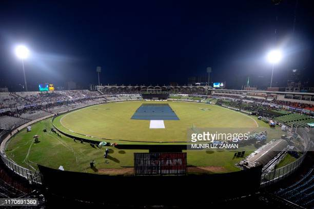 General view of the field is pictured as rain comes and delays the match during the third and final Twenty20 international match of a tri-nation...