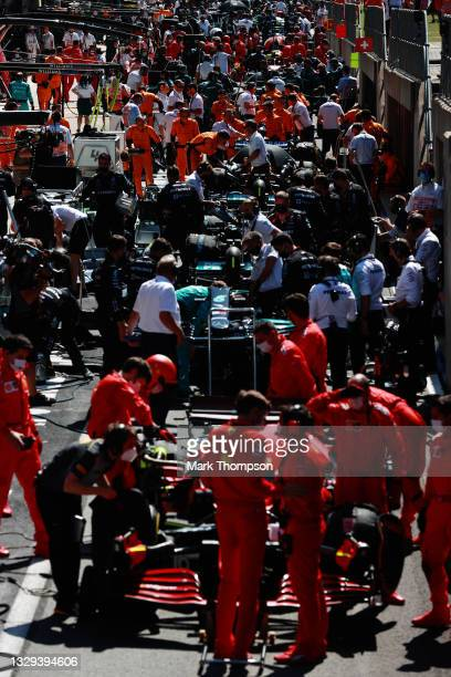 General view of the field stopped in the Pitlane for the red flag delay during the F1 Grand Prix of Great Britain at Silverstone on July 18, 2021 in...