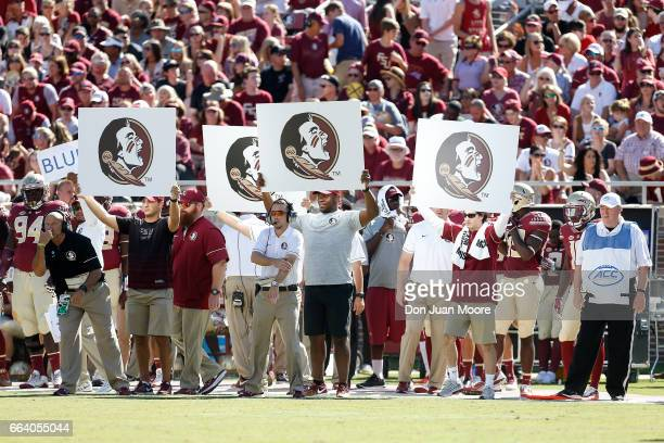 A general view of the Florida State Seminoles sidelines as they use cards to signal a play during the game against the North Carolina Tar Heels at...