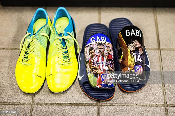 A general view of the football shoes and the shinguards of Gabi is seen in the dressing room of Madrid prior to the UEFA Champions League Round of 16...