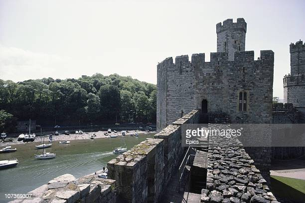 A general view of the fortifications of Caernarfon Castle Gwynedd Wales June 1983 Caernarfon castle is located at the southern end of the Menai...