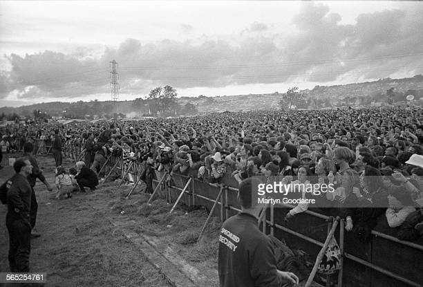 General view of the front rows of the crowd in front of the Pyramid Stage Glastonbury Festival United Kingdom 1990