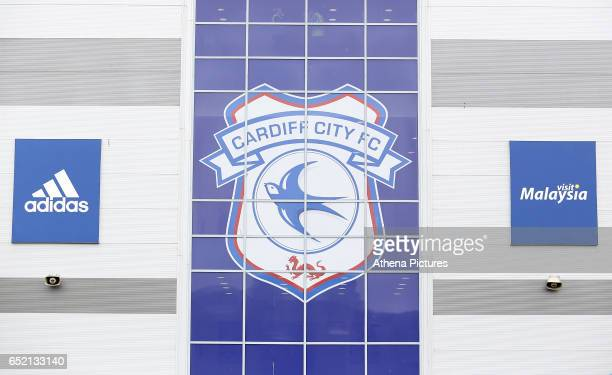A general view of the front window of the Cardiff City Stadium which is covered by the Cardiff City emblem with the Adidas and Visit Malaysia logos...