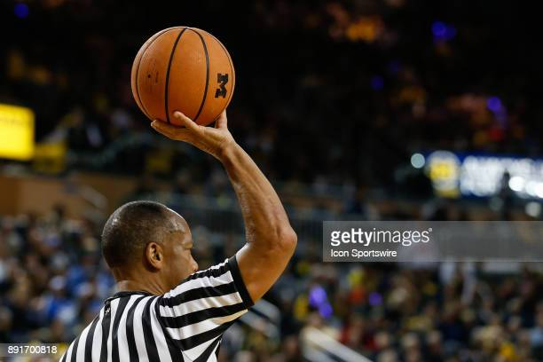 A general view of the game ball being held up by a referee is seen during a regular season nonconference basketball game between the UCLA Bruins and...