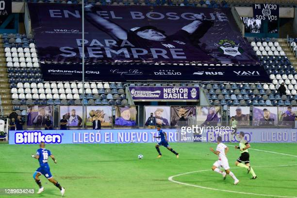 General view of the game while images of late Diego Maradona are displayed back in the stands during a match between Gimnasia y Esgrima La Plata and...