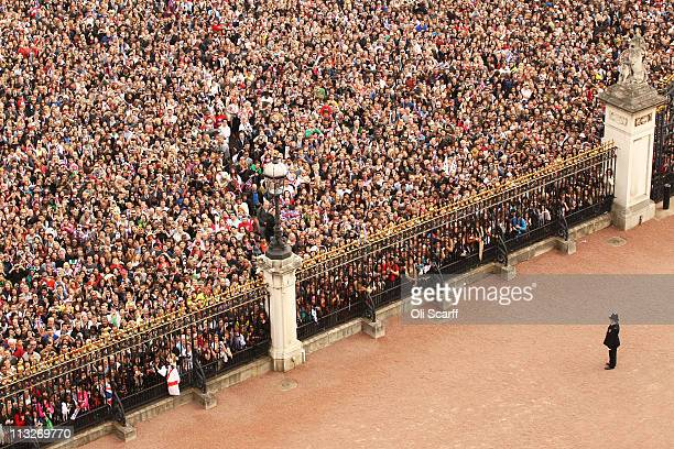 A general view of the gates of Buckingham Palace in front of the Victoria Memorial filled with wellwishers celebrating the Royal Wedding of Prince...