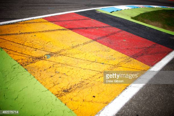 A general view of the German national flag painted on the track during previews ahead of the German Grand Prix at Hockenheimring on July 17 2014 in...