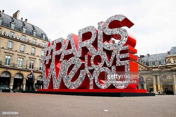 A general view of the giant hashtag #ParisWeLoveYou covered by a mosaic of photos at Place du Palais Royal on May 24 2016 in Paris France...