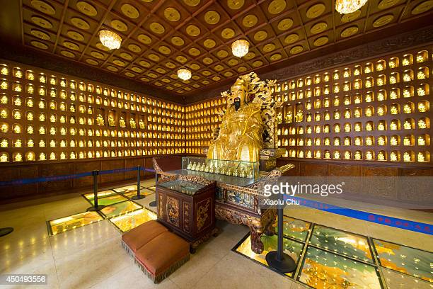 <A general view of the god of wealth's sculpute in the Temple of Great Maternal Grace in XiÕan XiÕan is the capital of Shanxi province and the...