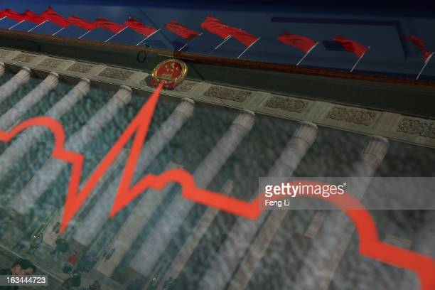 A general view of the Great Hall of the People refracted by the window of an ambulance during a plenary session of the National People's Congress on...