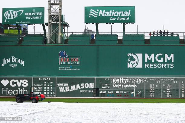 General view of the Green Monster as the tarp covers the field after the game between the Boston Red Sox and the Tampa Bay Rays was postponed due to...