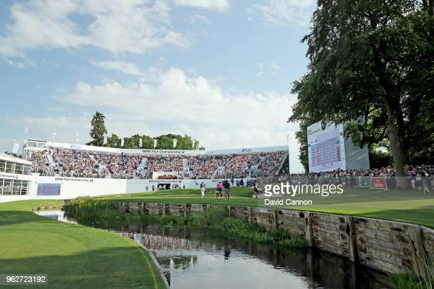 A general view of the green on the par 5 18th hole as Rory McIlroy of Northern Ireland and Sam Horsfield of England in the final group putt out...