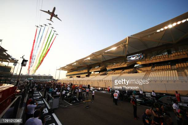 General view of the grid as an aerial display is seen over the circuit prior to the F1 Grand Prix of Abu Dhabi at Yas Marina Circuit on December 13,...
