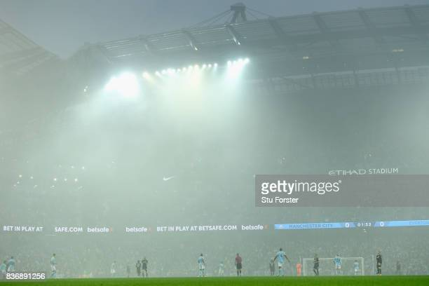 A general view of the ground as mist caused by fireworks linger during the Premier League match between Manchester City and Everton at Etihad Stadium...