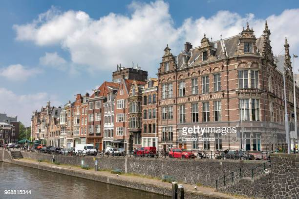 General view of the houses along the Nieuwe Herengracht Canal on May 30 2018 in Amsterdam Netherlands Amsterdam's buildings along the canals were...