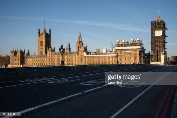 A general view of the Houses of Parliament as the sun rises on March 24 2020 in London England British Prime Minister Boris Johnson announced strict...