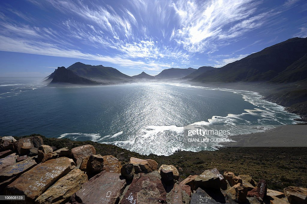 A general view of the Hout Bay harbour covered in mist is seen on May 8, 2010 from the Chapman's peak road on the outskirts of Cape Town. Chapman's peak road is the coastal link between Cape Town and the Cape of Good Hope. When following the African coastline from the equator the Cape of Good Hope marks the psychologically important point where one begins to travel more eastward than southward, thus the first rounding of the cape in 1488 by Portuguese explorer Bartolomeu Dias was a major milestone in the attempts by the Portuguese to establish direct trade relations with the Far East. He called the cape Cabo Tormentoso. As one of the great capes of the South Atlantic Ocean, the Cape of Good Hope has been of special significance to sailors for many years and is widely referred to by them simply as 'the Cape'. It is a major milestone on the clipper route followed by clipper ships to the Far East and Australia, and still followed by several offshore yacht races.