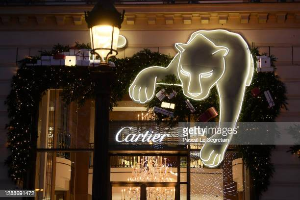 General view of the illuminated Cartier store on the Champs Elysees avenue for Christmas and New Year celebrations on November 30, 2020 in Paris,...