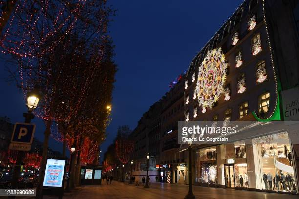 General view of the illuminated Dior store of the Champs Elysees avenue for Christmas and New Year celebrations on November 30, 2020 in Paris,...