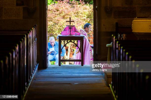 A general view of the interior of St Paul's Anglican Church in Burwood is seen with members of the congregation seated outside on March 22 2020 in...