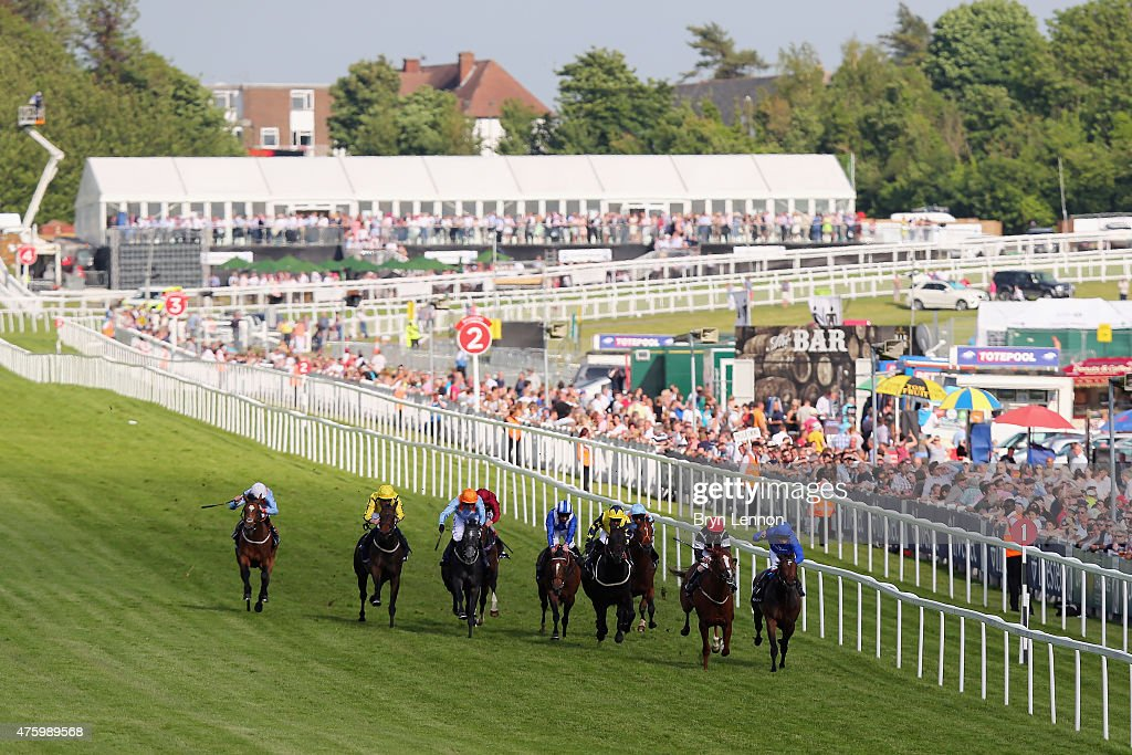 A general view of The Investec Surrey Stakes race during the Investec Ladies Day at Epsom Racecourse on June 5, 2015 in Epsom, England.
