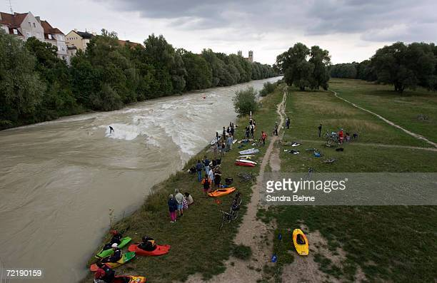 A general view of the Isar river and it's surfers at Wittelsbacher bridge on August 9 2006 in Munich Germany The history of surfing the Eisbach goes...