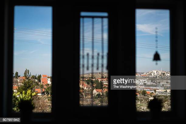 A general view of the Jewish settlement of Ofra and the Palestinian village of Silwad from inside one of the rooms of 'Nof Ofra' bed and breakfast...