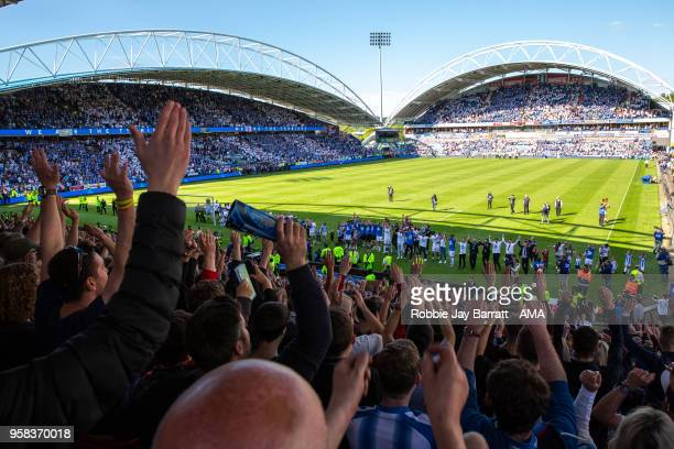 A general view of The John Smiths Stadium home stadium of Huddersfield Town as Huddersfield Town players and staff celebrate with the fans at full...