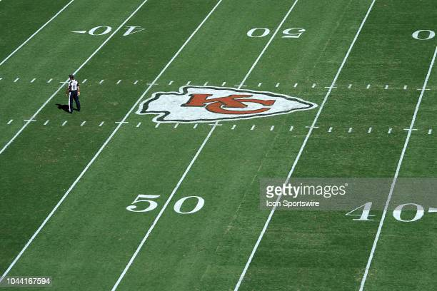 A general view of the Kansas City Chiefs logo is seen at the 50 yard line on the field at Arrowhead Stadium in action during an NFL game between the...