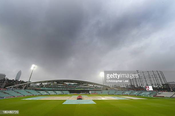 General view of the Kia Oval with the covers on the pitch and rain clouds during the Semi Final match between Wimbledon and Banbury in the ECB...
