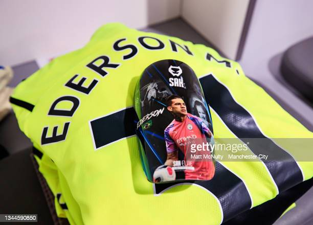 General view of the kit and shin pads worn by Ederson of Manchester City prior to the Premier League match between Liverpool and Manchester City at...