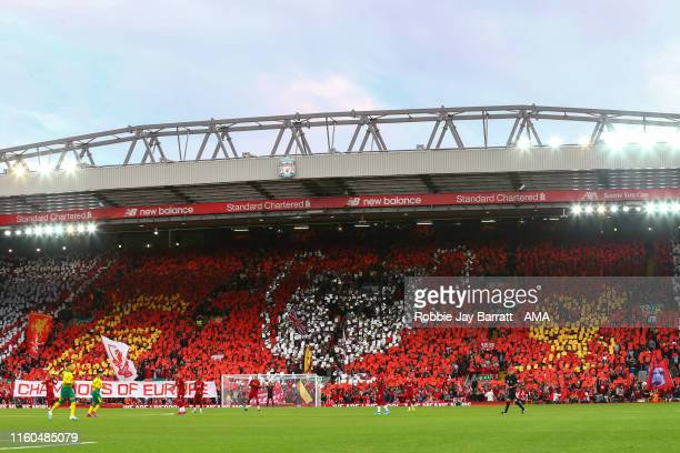 A general view of The Kop at Anfield stadium as the fans celebrate winning their sixth UEFA Champions League Trophy with a mosaic during the Premier...