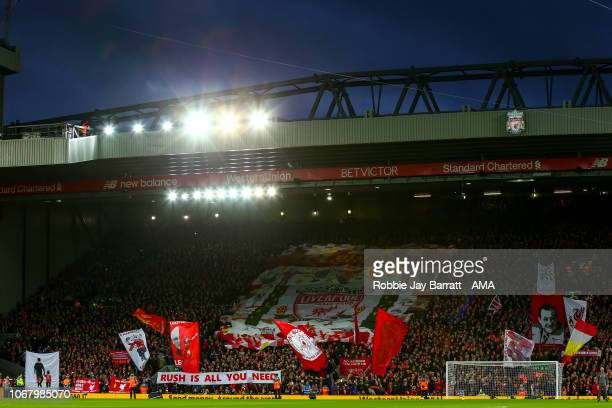 A general view of The Kop at Anfield the home stadium of Liverpool as fans hold up flags and banners during the Premier League match between...