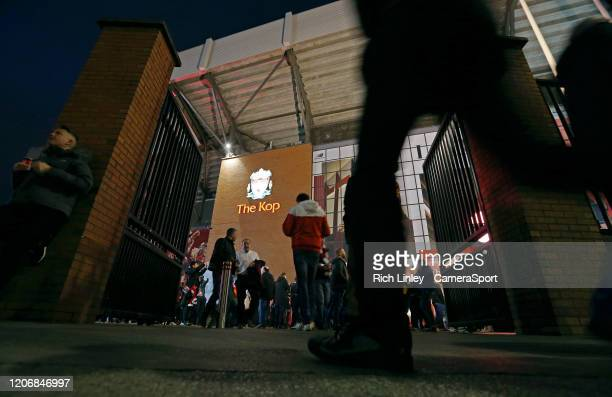 A general view of The Kopp entrance as fans arrive at Anfield ahead of the UEFA Champions League round of 16 second leg match between Liverpool FC...