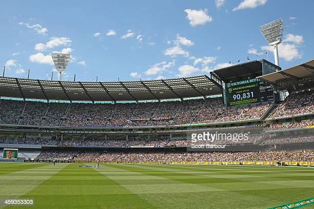 A general view of the large crowd as the large screen displays the official attendance of 90831 spectators during day one of the Fourth Ashes Test...