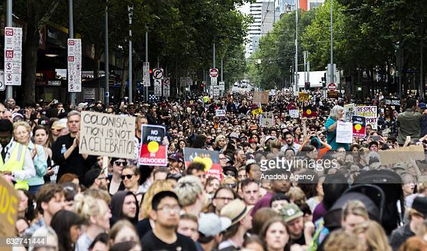 A general view of the large crowd as they sit on the floor down Swanston street during a protest organized by Aboriginal rights activists on...