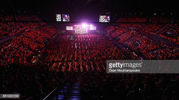 A general view of the large crowd mainly wearing the national colour of Orange cheers as Raymond van Barneveld of the Netherlands plays a shot in his...