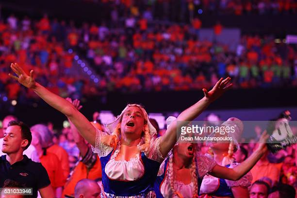 A general view of the large crowd mainly wearing the national colour of Orange and these men wearing milk maid outfits cheer as Raymond van Barneveld...