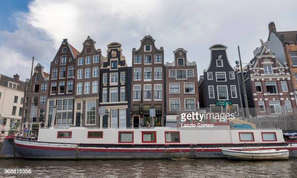 General view of the 'Leaning Houses' on the riverside of Amstel river on May 30 2018 in Amsterdam Netherlands This group of canal houses is one of...