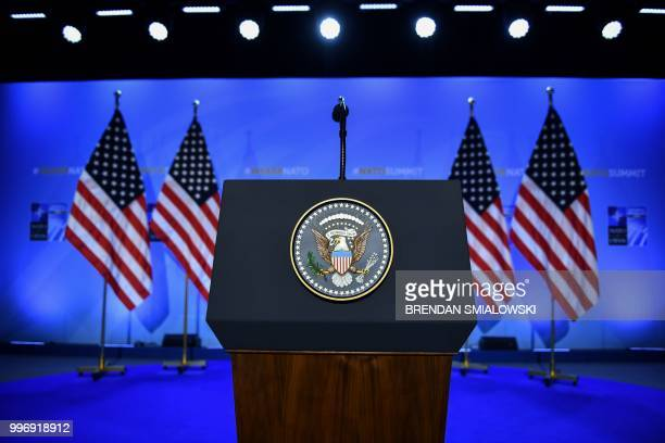 General view of the lectern prior to the press conference of the US President during the second day of the NATO summit in Brussels on July 12 2018