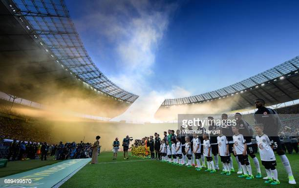 A general view of the lineup of the teams during the DFB Cup final match between Eintracht Frankfurt and Borussia Dortmund at Olympiastadion on May...