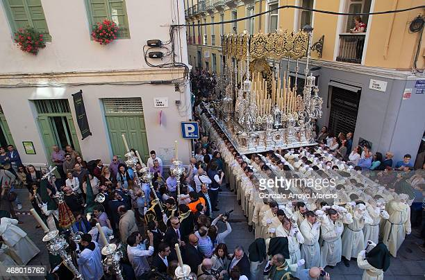 A general view of the Maria Santisima de Lagrimas y Favores trone as it takes a corner during its procession during Holy Week celebrations on March...